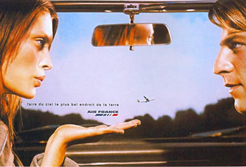 Flight ad of a woman and men sitting in a car and seeing a plane on the sky