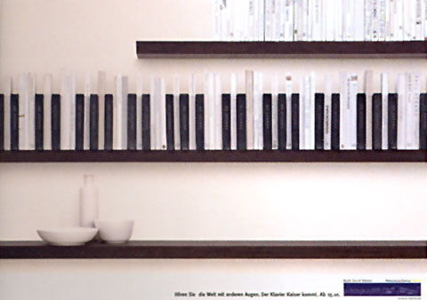 Ad for a piano shop showing the sky with a line of hanging socks in shape of piano keys in the forground