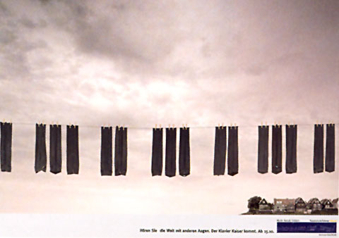 Ad for a piano shop showing the sky with a line of hanging socks in shape of piano keys in the foreground