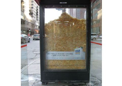 Ad showing a chips inside the window of a bus stop place