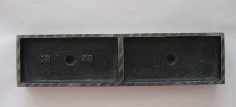 Metal that helps to position the letter blocks on the press in the size 40 x 10 pica
