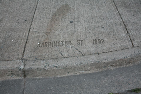 Street name written in conrete of pavewalk