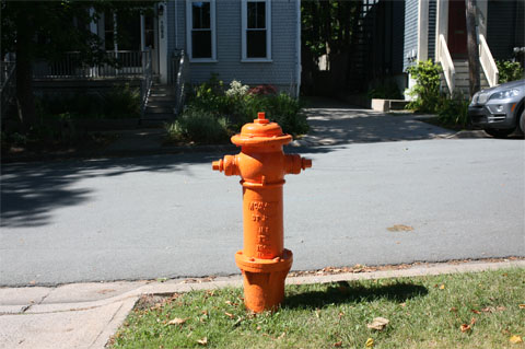 Orange hydrant on streets