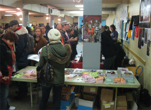 many people attenting the church basement where Expozine, the book fair, takes place.