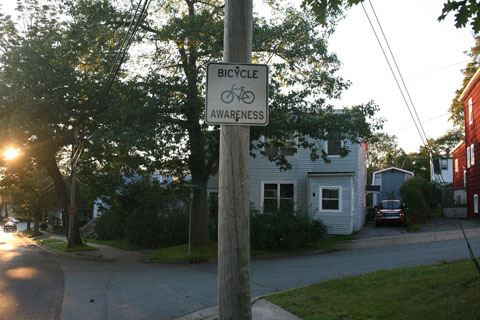 Sign on street promoting bicylcle awareness