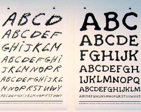 Two typography posters on gallery wall
