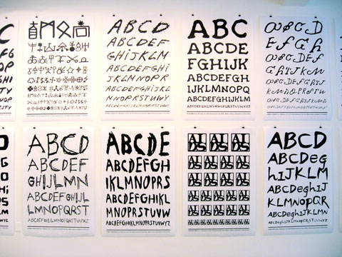 Typography posters on gallery wall