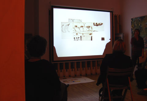 Elmyna Bouchard presenting her work in front of a screen