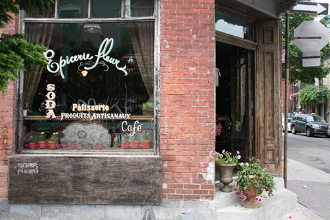 Detail of hand lettering of the word 'fuchsia' on Montreal restaurant window