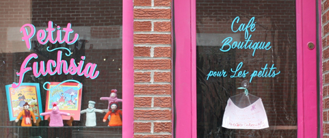 Detail of hand lettering of the word 'petit fuchsia' on Montreal restaurant window