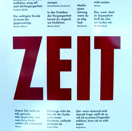 Poster with Letterpress prints. Written is the word 'Zeit' and other poems