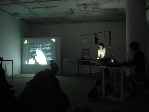 Projection of drawings and artist's fingers