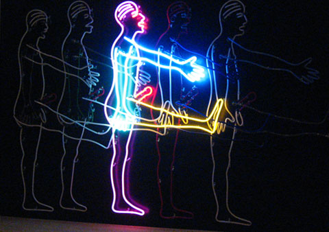 A man in movement, a neon art piece by Bruce Nauman