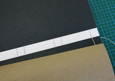 Visible thread on spine interior of book using European stitching binding