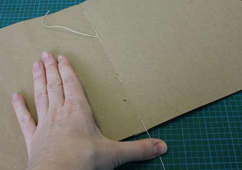 Thread on spine interior of book using European stitching binding