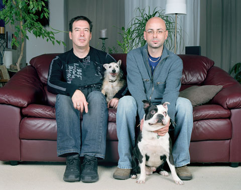 A portrait of Andre and his dog Lady with Jacques and the dog Brutus, from the photography project 'Dog | Dog Owner'