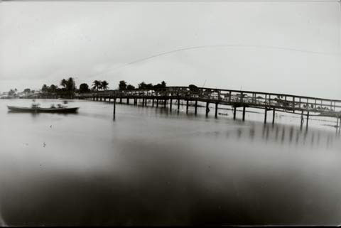 bridge over water, from the pinhole photography project 'Favela - Ilha de Deus Pinhole'