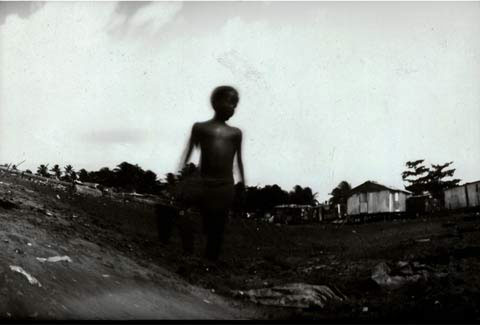 boy, from the pinhole photography project 'Favela - Ilha de Deus Pinhole'