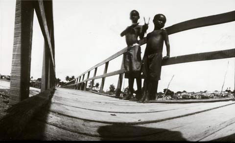 2 boys standing on bridge, from the pinhole photography project 'Favela - Ilha de Deus Pinhole'