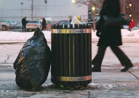 Garbage Can on Boulevard de Maisonneuve, Corner Rue Guy with walking people in the background