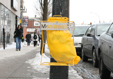 Garbage Can, which consists in a yellow plastic bag mounted on a street light, on Rue Jean-Talon E, Corner Avenue Henri-Julien