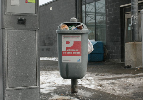 Garbage Can, which consists in a small grey container, on Boulevard Rosemont, Corner Rue St-Denis