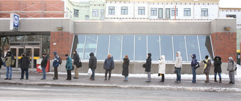 People waiting for the bus at Bus stop #460/202, Metro Station Du College, Montreal February 6 2007