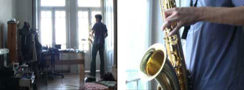 A young man standing in his room and playing the sax, from the documentary 'HomeSweetHome'.