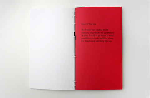 Double page on white and red paper containing text