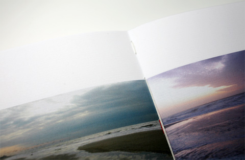 Close view of a page containing a photograph of the sea