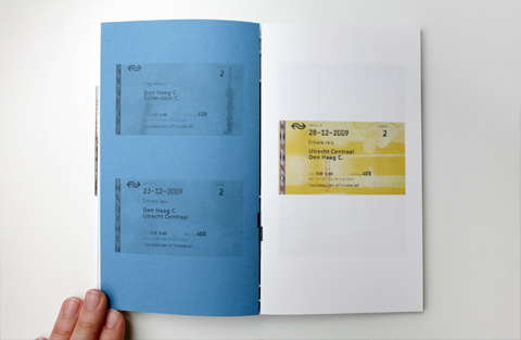 Double page on blue and white paper containing train tickets
