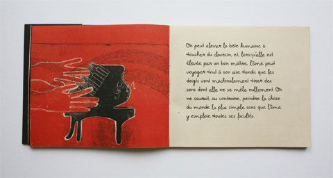 Book page with illustrated piano and text page