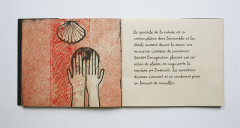 Book page with illustrated hands and text page