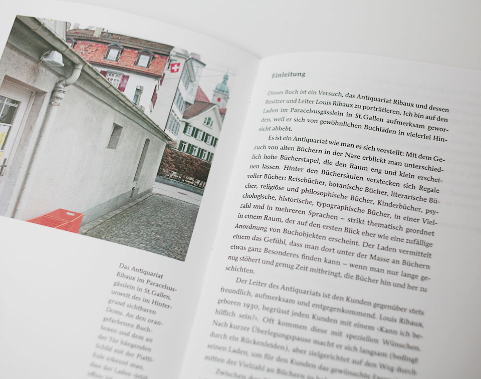 open spread of book containing text and an image with building
