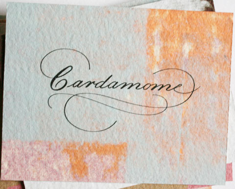 Card with the letters cardamome