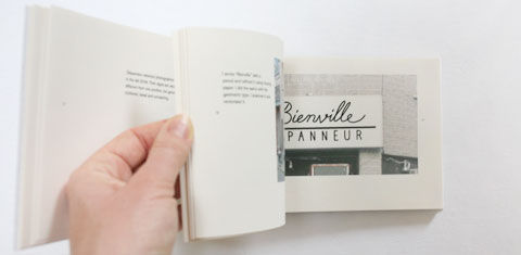 Flipping pages at script lettering page in Lettering depanneur signs book
