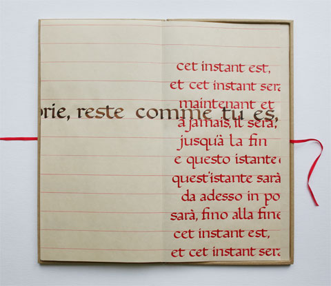 Open box with page containing mainly red calligraphic lines