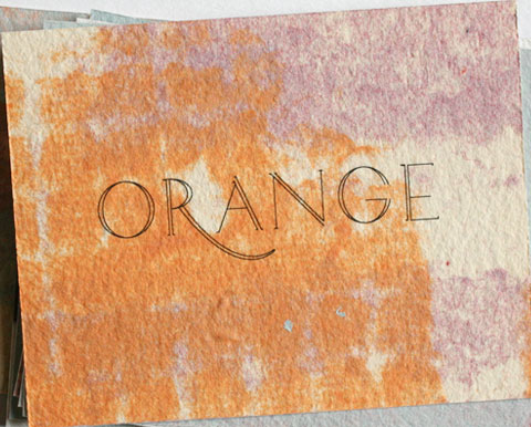 Card with the letters orange