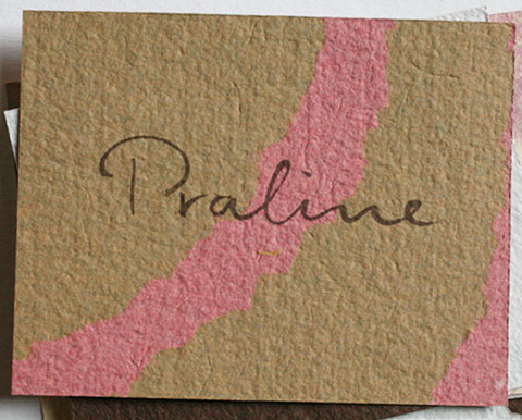 Card with the letters praline