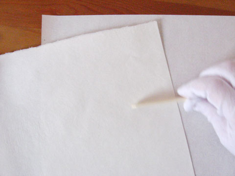 Folding the sheet of paper